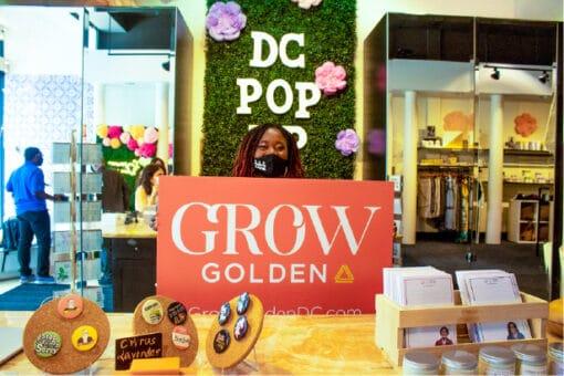 Rahama with Grow Golden sign-100